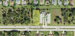 Photo of 270 Rotonda Boulevard W, ROTONDA WEST, FL 33947 (MLS # D6114029)