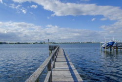 Photo of 1100 Boca Ciega Isle Drive, ST PETE BEACH, FL 33706 (MLS # U7754773)