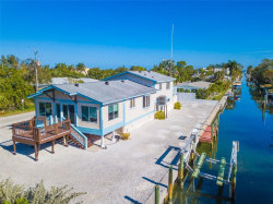 Photo of 580 Jungle Queen Way, LONGBOAT KEY, FL 34228 (MLS # A4406404)