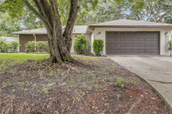 Photo of 8959 Pohoy Avenue, SARASOTA, FL 34231 (MLS # A4477615)