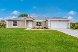 Photo of 12014 Booth Avenue, PORT CHARLOTTE, FL 33981 (MLS # D6112344)