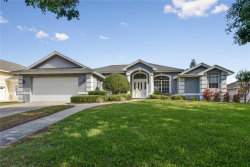 Photo of 8013 Old Town Drive, ORLANDO, FL 32819 (MLS # O5574047)
