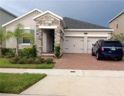 Photo of 9899 Magnolia Woods Boulevard, ORLANDO, FL 32832 (MLS # O5721249)