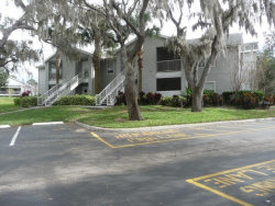 Photo of 712 Secret Harbor Lane, Unit 100, LAKE MARY, FL 32746 (MLS # O5752847)