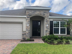 Photo of 325 Meadow Pointe Drive, HAINES CITY, FL 33844 (MLS # O5768264)