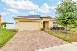 Photo of 136 Whispering Pines Way, DAVENPORT, FL 33837 (MLS # O5771493)