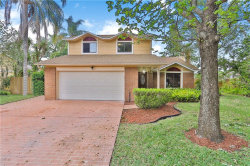 Photo of 9741 Lake Douglas Place, ORLANDO, FL 32817 (MLS # O5776719)