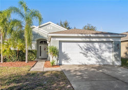 Photo of 1728 Setting Sun Loop, CASSELBERRY, FL 32707 (MLS # O5838028)