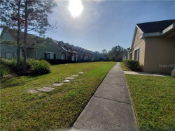 Photo of 1944 Island Walk Drive, ORLANDO, FL 32824 (MLS # O5838170)