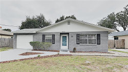 Photo of 10411 N Ojus Drive, TAMPA, FL 33617 (MLS # O5838693)