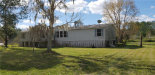 Photo of 3213 Cypress Trails Drive, POLK CITY, FL 33868 (MLS # P4904657)