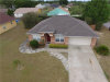 Photo of 607 Heather Glen Loop, WINTER HAVEN, FL 33884 (MLS # P4910432)
