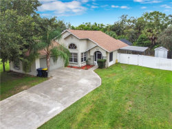 Photo of 612 Berkley Pointe Dr, AUBURNDALE, FL 33823 (MLS # S5040858)