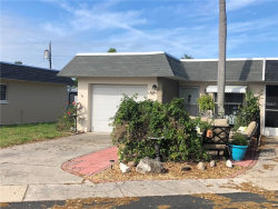 Photo of 242 W Skyloch Drive W, DUNEDIN, FL 34698 (MLS # U8038391)