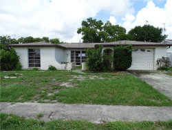 Photo of 1332 Maybury Drive, HOLIDAY, FL 34691 (MLS # U8049247)