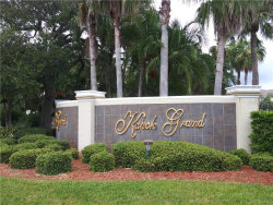 Photo of 11264 Kapok Grand Circle, MADEIRA BEACH, FL 33708 (MLS # U8056902)