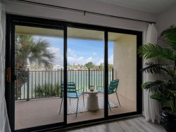 Photo of 7435 Bayshore Drive, Unit 202, TREASURE ISLAND, FL 33706 (MLS # U8097703)