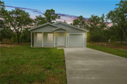 Photo of 13028 Marsh Hawk Road, WEEKI WACHEE, FL 34614 (MLS # W7823684)