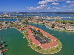 Photo of 519 Plaza Seville Court, Unit 37, TREASURE ISLAND, FL 33706 (MLS # U8016386)