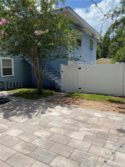 Photo of 136 1/2 30th Ave N, SAINT PETERSBURG, FL 33704 (MLS # U8091806)