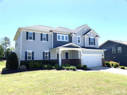 Photo of 813 Teal Lake Drive, Holly Springs, NC 27540 (MLS # 2236619)