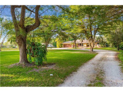 Photo of 14321 Mustang Trl, Southwest Ranches, FL 33330 (MLS # A10221750)