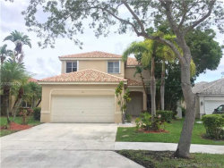 Photo of 593 Willow Bend Rd, Weston, FL 33327 (MLS # A10290426)