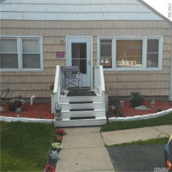 Photo of 56 Bogota Rd, Mastic Beach, NY 11951 (MLS # 2956058)
