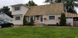 Photo of 20 Harrison St., Brentwood, NY 11717 (MLS # 3052818)