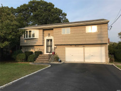 Photo of 100 Trouville Rd, Copiague, NY 11726 (MLS # 3065836)