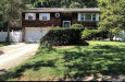 Photo of 9 Barrington Dr, Wheatley Heights, NY 11798 (MLS # 3097367)