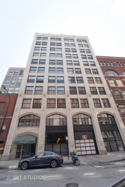 Photo of 523 S Plymouth Court, Unit Number 703, CHICAGO, IL 60605 (MLS # 09662813)