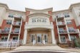 Photo of 601 W Rand Road, Unit Number 303, ARLINGTON HEIGHTS, IL 60004 (MLS # 09844103)