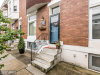 Photo of 309 LORRAINE AVE E, Baltimore, MD 21218 (MLS # BA9989634)