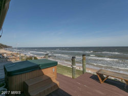 Photo of 635 CLUBHOUSE DR, Unit 7, Lusby, MD 20657 (MLS # CA9993434)