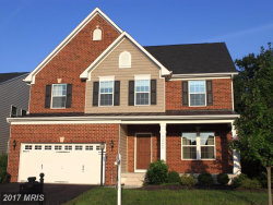 Photo of 24982 GREAT BERKHAMSTED DR, Aldie, VA 20105 (MLS # LO10052965)