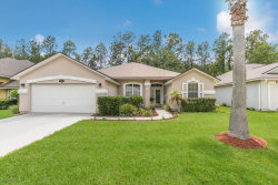 Photo of 8748 Canopy Oaks DR, JACKSONVILLE, FL 32256 (MLS # 942534)