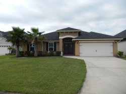 Photo of 1813 Sugar Maple RD, FLEMING ISLAND, FL 32003 (MLS # 1059288)