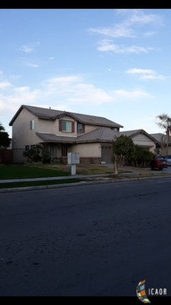Photo of 312 Countryside DR, El Centro, CA 92243 (MLS # 19424706IC)